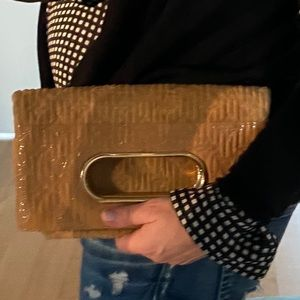 Authentic Louis Vuitton Tan blind embossed clutch